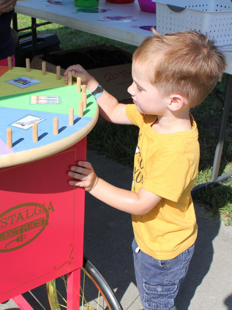 Boy spins prize wheel